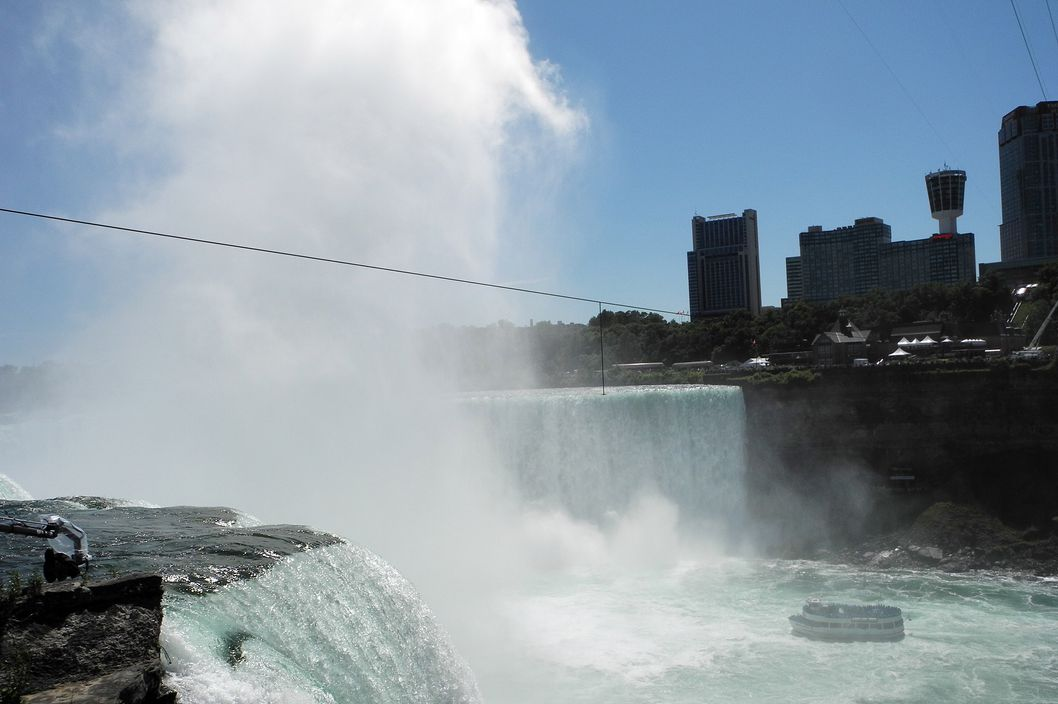 A tourist ship in Niagara Falls, New York, on June 14, 2012, passes under the tight rope which will be used by high-wire walker Nik Wallenda, 33, on June 15 to cross from the US to Canada over the Horseshoe section of the falls. The wire is 1,550 feet (472 meters) long. Wallenda will be suspended 173 feet (53 meters) above the falls.