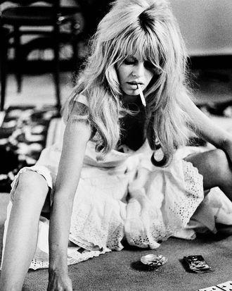 Brigitte Bardot plays cards on the set of <i>Viva Maria</i>, 1965.