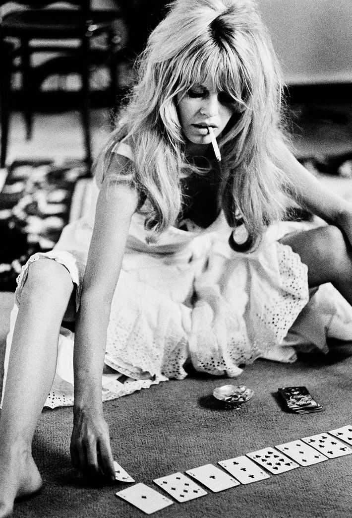 Brigitte Bardot plays cards on the set of <i>Viva Maria</i>, 1965.