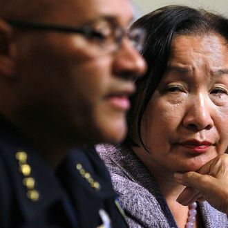 OAKLAND, CA - OCTOBER 26: Oakland Mayor Jean Quan (R) looks on as police chief Howard Jordan speaks during a press conference on October 26, 2011 in Oakland, California. Oakland Mayor Jean Quan held a press conference to address police action taken on Occupy protesters who staged a demonstration in downtown Oakland on Tuesday evening. Nearly 100 protesters were arrested. (Photo by Justin Sullivan/Getty Images)