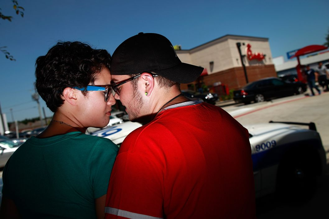 DALLAS, TX - AUGUST 03:  (L-R) Same sex couple Whitney Copeland and Skye Newkirk embrace outside a Chick-fil-A restaurant on August 3, 2012 in Dallas, Texas. Several same sex couples gathered to kiss in support of a National Same Sex Kiss Day at Chick-fil-A held across the country in response to Chick-fil-A's stance on gay marriage.  (Photo by Tom Pennington/Getty Images)