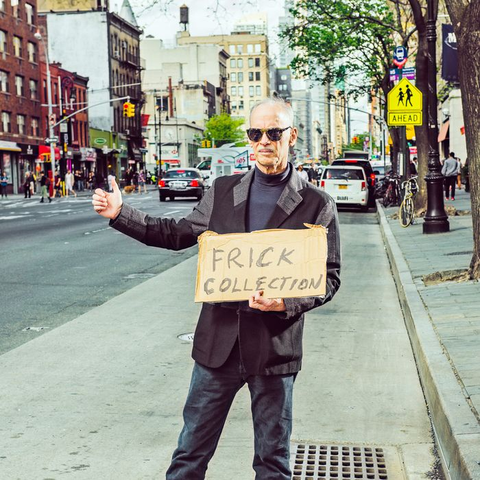John Waters with his hitchhiking sign at 12th st and 6th ave