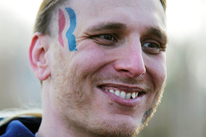 Eric Hartsburg, 30, poses for a photo showing his Romney-Ryan election logo tattoo Friday, Nov. 30, 2012 in Michigan City, Ind. Hartsburg, a professional wrestler, said he hoped the 5-by-2-inch tattoo would make politics more fun and had initially resigned himself to keeping it, but he is now planning to have it removed. (AP Photo/Teresa Crawford)