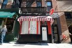 Cheery red-and-white-striped awning.