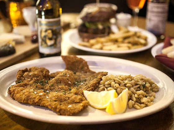 Classic Wiener Schnitzel: breaded veal cutlet with lemon and pan-fried spaetzle.