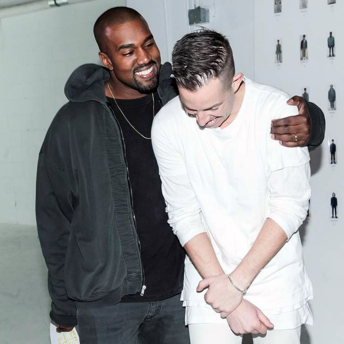Kanye West with designer John Elliott.