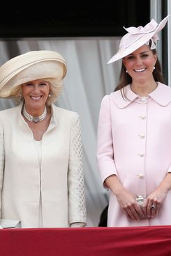 LONDON, ENGLAND - JUNE 15:  Camilla, Duchess of Cornwall and Catherine, Duchess of Cambridge laugh on the balcony of Buckingham Palace during the annual Trooping the Colour Ceremony on June 15, 2013 in London, England. Today's ceremony which marks the Queens official birthday will not be attended by Prince Philip the Duke of Edinburgh as he recuperates from abdominal surgery and will also be The Duchess of Cambridge's last public engagement before her baby is due to be born next month.  (Photo by Chris Jackson/Getty Images)