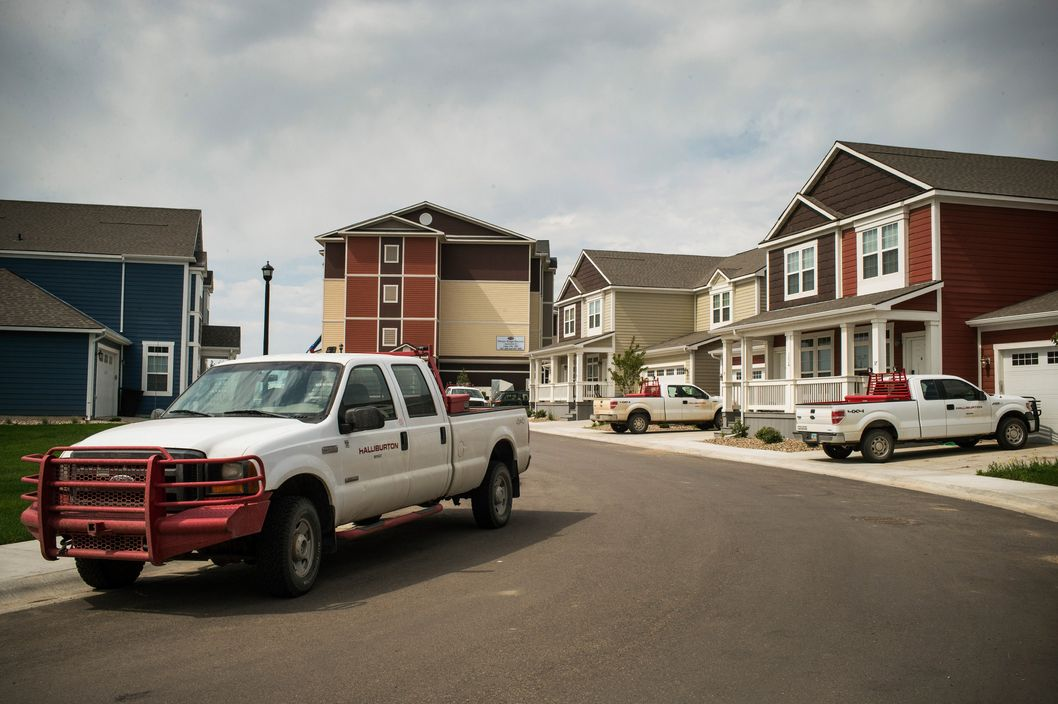 WILLISTON, ND - JULY 28:  Trucks are parked near new homes rented by oil workers on July 28, 2013 in Williston, North Dakota.  North Dakota has been experiencing an oil boom in recent years, due in part to new drilling techniques including hydraulic fracturing and horizontal drilling. In April 2013, The United States Geological Survey released a new study estimating the Bakken formation and surrounding oil fields could yield up to 7.4 billion barrels of oil, doubling their estimate of 2008, which was stated at 3.65 billion barrels of oil.  (Photo by Andrew Burton/Getty Images)
