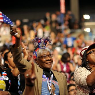 Chaz Rodgees, left, Myrtis Evans, center, and Addie D. Allen, delegates from Texas, cheer during day two of the Democratic National Convention (DNC) in Charlotte, North Carolina, U.S., on Wednesday, Sept. 5, 2012. Democratic officials have moved President Barack Obama's nomination acceptance speech tomorrow night to the Time Warner Cable Arena from the larger, outdoor Bank of America Stadium because of the possibility of severe weather.