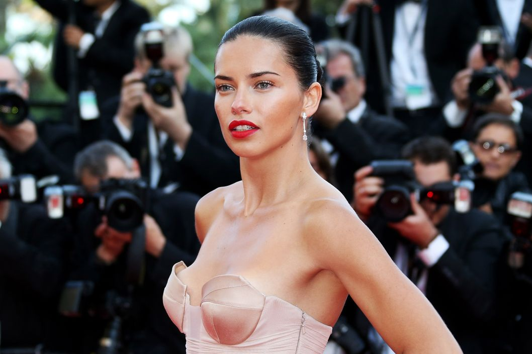 "Brazilian model Adriana Lima poses as she arrives for the screening of the film ""The Homesman"" at the 67th edition of the Cannes Film Festival in Cannes, southern France, on May 18, 2014."