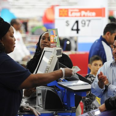 "An employee rings up sales at a cash register at a  Walmart in the Crenshaw district of Los Angeles on Black Friday, November 29, 2013. US stocks Friday moved higher in a holiday-shortened session following better eurozone economic data and positive early assessments of ""Black Friday"" shopping traffic by some leading retailers.    AFP PHOTO / Robyn Beck        (Photo credit should read ROBYN BECK/AFP/Getty Images)"