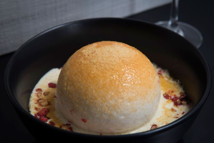 Ile Flotant: a soft meringue floating in crème anglaise with red praline.