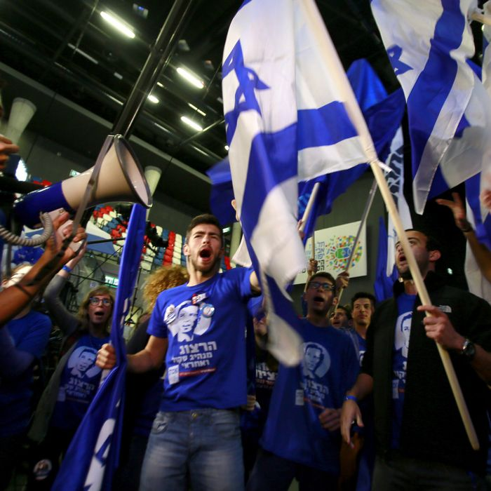 Supporters of the centre-left Zionist Union party take part in early celebrations outside the party's headquarters as they wait for the announcement of the first official results of the Israel's parliamentary elections on March 17, 2015 in the city of Tel Aviv. Israelis voted in a close-fought election pitting the centre left against Prime Minister Benjamin Netanyahu who is fighting for his political survival after six years in power. AFP PHOTO / GALI TIBBON (Photo credit should read GALI TIBBON/AFP/Getty Images)