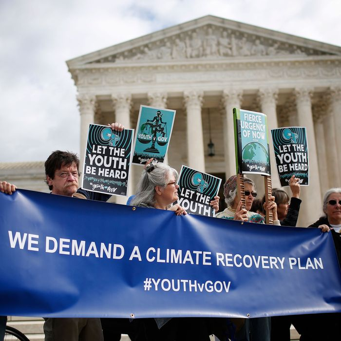 Protesters attend a rally outside the U.S. Supreme Court held by the group Our Children's Trust October 29, 2018 in Washington, DC. The group rallied in support of the Juliana v. U.S. lawsuit brought on behalf of 21 youth plaintiffs that argues the U.S. government has violated constitutional rights for more than 50 years by contributing to climate change.