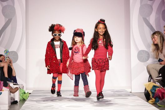 A model walks the runway at the Truly Scrumptious designed by Heidi Klum at Vogue Bambini petiteParade Kids Fashion Week on October 5, 2013 in New York City.