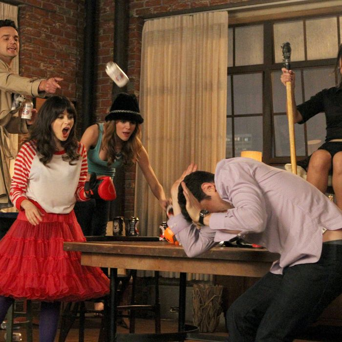 NEW GIRL: L-R: Nick (Jake Johnson), Jess (Zooey Deschanel), Holly (guest star Brooklyn Decker), Schmidt (Max Greenfield) and Daisy (guest star Brenda Song) play a heated game of
