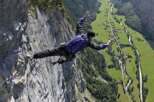 Dean Potter executes a free solo climb and fall with parchute in summer 2008 at Lauterbrunnen in Switzerland.