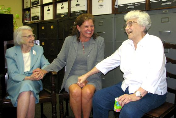 FILE - in this Sept. 11, 2006 file photo, attorney Alice Lee, left, accepts birthday wishes from Monroe County Circuit Judge-elect Dawn Hare, center, and her sister, Pulitzer-winning author Harper Lee, right, in Monroeville, Ala.  Alice Lee has died, she was 103.   Johnson Funeral Home in Monroeville posted an online obituary saying Lee died Monday, Nov. 17, 2014.  .  No cause of death was given, and the announcement says arrangements are incomplete.  Lee practiced law until a few years ago, and for  a time she was Alabama's oldest practicing attorney.  (AP Photo/AL.com, Connie Baggett)  MAGS OUT