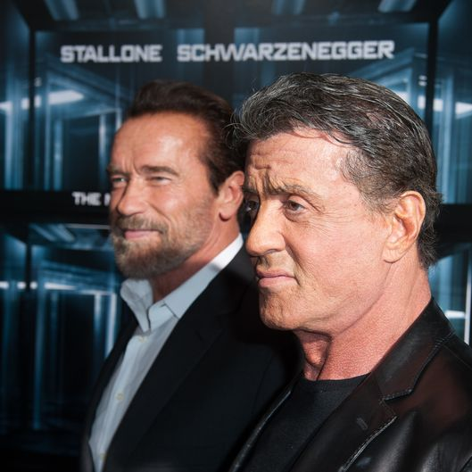 "NEW YORK, NY - OCTOBER 15:  Actor Arnold Schwarzenegger and Sylvester Stallone attends ""Escape Plan"" New York Premiere at Regal E-Walk on October 15, 2013 in New York City.  (Photo by Dave Kotinsky/Getty Images)"