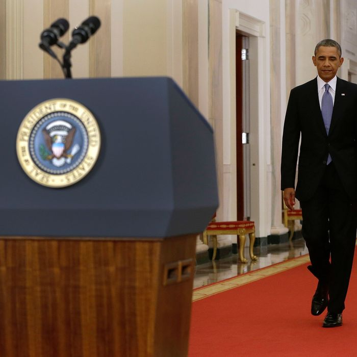 WASHINGTON, DC - SEPTEMBER 10: U.S. President Barack Obama walks to the podium before addressing the nation in a live televised speech from the East Room of the White House on September 10, 2013 in Washington, DC. President Obama blended the threat of military action with the hope of a diplomatic solution as he works to strip Syria of its chemical weapons. (Photo by Evan Vucci-Pool/Getty Images)