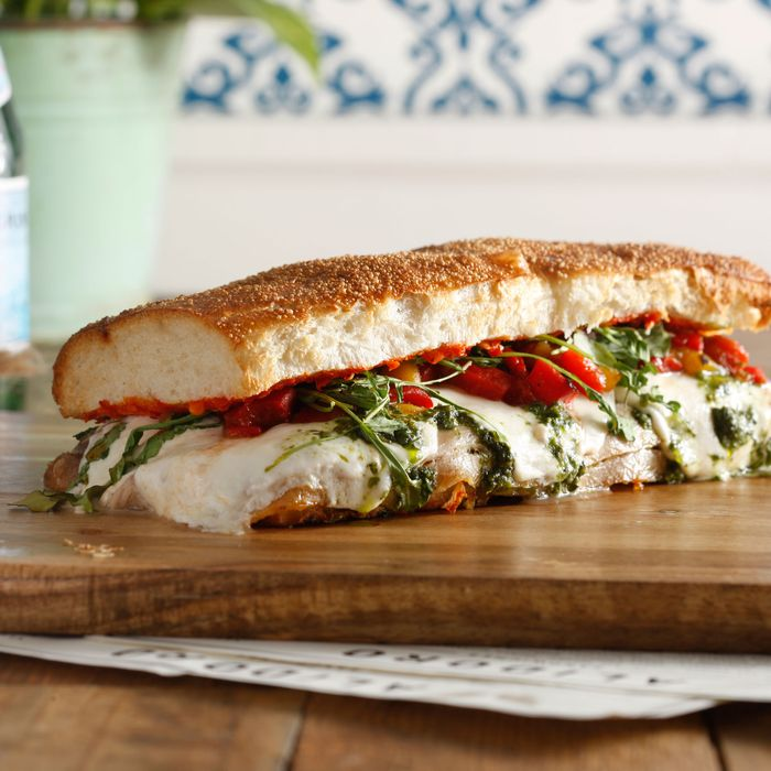 Fratelli d'Italia: porchetta, basil pesto, fresh mozzarella, hot peppers, sweet peppers, and arugula.