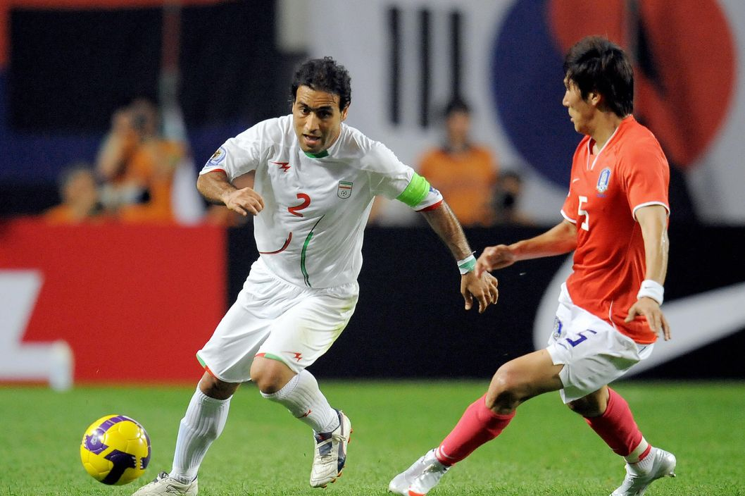 Iran's Mehdi Mahdavikia (L), wearing a green wrist band, and South Korea's Kim Dong-Jin (R) fight for the ball during the 2010 World Cup Asian qualifier football match at the Seoul World Cup Stadium on June 17, 2009. The match ended 1-1. AFP PHOTO/JUNG YEON-JE (Photo credit should read JUNG YEON-JE/AFP/Getty Images)