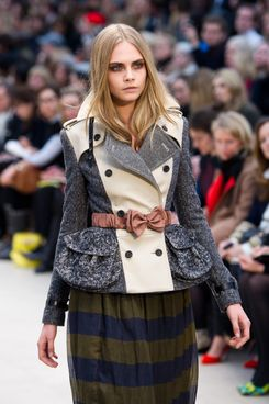 Cara Delevingne walks the runway during the Burberry Prorsum show at London Fashion Week Autumn/Winter 2012 at Kensington Gardens on February 20, 2012 in London, England.