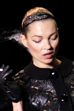 Kate Moss walks the runway at the Louis Vuitton Ready to Wear Autumn/Winter 2011/2012 show during Paris Fashion Week at Cour Carree du Louvre on March 9, 2011 in Paris, France.