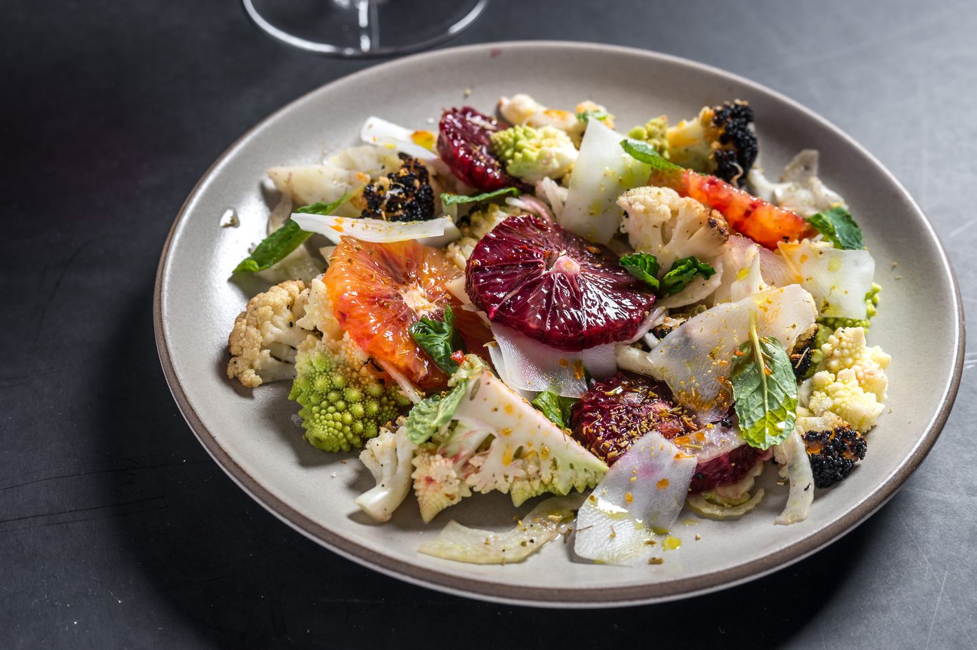 Charred-cauliflower salad with blood orange, mint, and hot peppers.
