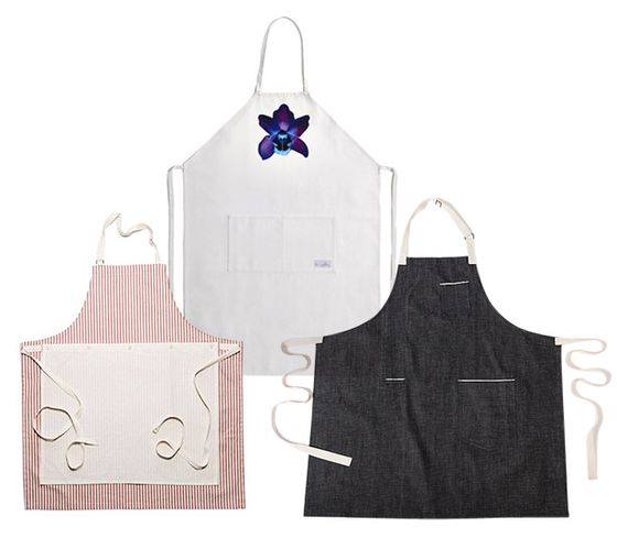 "There's a new wave of well-designed aprons that protect your clothes and make you look good in the process: Check out Alton Brown's denim collaboration with Hedley and Bennet, an option from Kauffman Mercantile with a detachable cotton muslin towel, or any of the eight options available from Yoox, which tapped Italian fashion houses such as Moschino and Trussardi to design aprons that also benefit the Slow Food Foundation for Biodiversity. <a href=""http://store.kaufmann-mercantile.com/collections/new-items/products/kdh-x-km-ticking-apron-cranberry"">Kauffman Mercantile Ticking Apron</a>, $89.95; <a href=""http://www.yoox.com/selection?name=aprons"">Yoox Holiday Apron Collection</a>, $97; <a href=""http://www.opensky.com/hedley-and-bennett/product/exclusive-alton-brown-designed-apron"">Alton Brown x Hedley and Bennet</a>, $75"