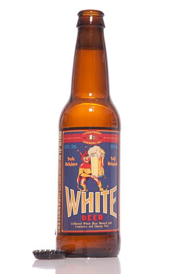 "Lakefront Brewery (Wisconsin)<br>$1.59 for 12 oz. <br><strong>Type:</strong> Witbier<br><strong>Tasting notes:</strong> ""A great, delicate beer for a warm summer day. The nose is yeasty, with a light aroma of fruit and spice. This beer is crisp and refreshing, with the wheat malt supplying a full, somewhat sweet background to the orange and coriander flavor. Spritzy carbonation lifts the sweetness to lend a crisp finish."" <br>—Jay Steinhauer, head of sales, American Beer Distributing Company<br> <br>"