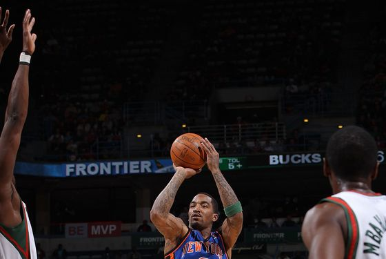 MILWAUKEE, WI - APRIL 11:  J.R. Smith #8 of the New York Knicks shoots against Ekpe Udoh #13 of the Milwaukee Bucks on April 11, 2012 at the Bradley Center in Milwaukee, Wisconsin. NOTE TO USER:  User expressly acknowledges and agrees that, by downloading and or using this Photograph, user is consenting to the terms and conditions of the Getty Images License Agreement.  Mandatory Copyright Notice:  Copyright 2012 NBAE (Photo by Gary Dineen/NBAE via Getty Images)