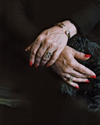 One woman's jewelry includes a double-C Cartier bracelet-and-ring set.