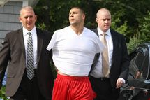 NORTH ATTLEBOROUGH, MA - JUNE 25: New England Patriots tight end Aaron Hernandez was arrested and led out of his home in handcuffs, shortly before 9 a.m. It is not immediately known what charges he is facing, but he has been under investigation in connection with the murder of Odin Lloyd.  (Photo by George Rizer for The Boston Globe via Getty Images)