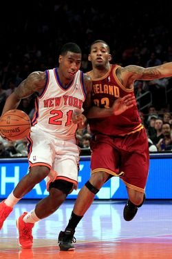 Iman Shumpert #21 of the New York Knicks drives against Alonzo Gee #33 of the Cleveland Cavaliers at Madison Square Garden on February 29, 2012 in New York City.
