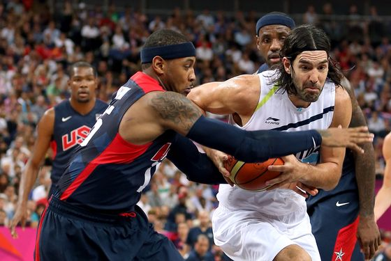 LONDON, ENGLAND - AUGUST 10:  Luis Scola #4 of Argentina drives between Carmelo Anthony #15 and LeBron James #6 of United States in the first half during the Men's Basketball semifinal match on Day 14 of the London 2012 Olympic Games at the Basketball Arena on August 10, 2012 in London, England.  (Photo by Christian Petersen/Getty Images)