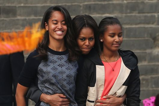 XI'AN, CHINA - MARCH 24:  First Lady Michelle Obama (Center) with her daughters Malia Obama (Left) and Sasha Obama (Right), mother Marian Robinson visit the Xi'an City Wall on March 24, 2014 in Xi'an, China. Michelle Obama's one-week-long visit in China will be focused on educational and cultural exchanges.  Michelle Obama's one-week-long visit in China will be focused on educational and cultural exchanges.  (Photo by Feng Li/Getty Images)