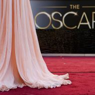 Antonella Michelena, a television reporter from Mexico, is silhouetted as she reports from the red carpet outside the Dolby Theatre in the Hollywood section of Los Angeles, Friday, Feb. 22, 2013 as preparations for this Sunday's 85th Academy Awards continue. (AP Photo/Jae C. Hong)