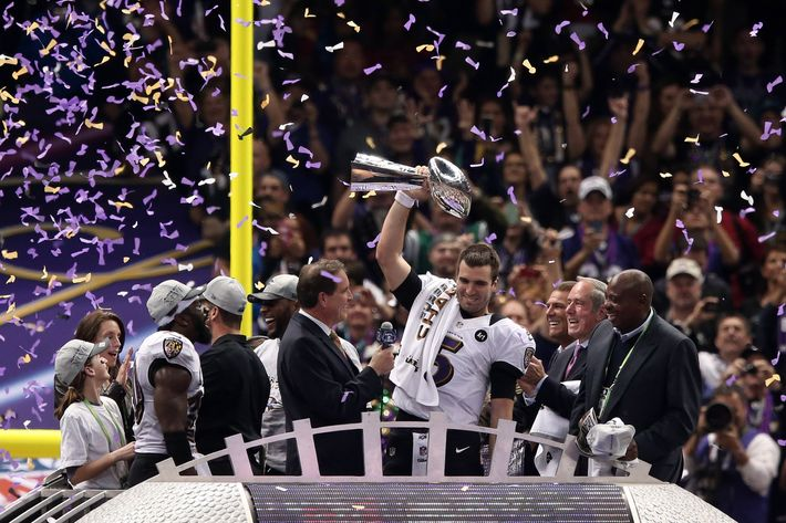 NEW ORLEANS, LA - FEBRUARY 03:  Super Bowl MVP Joe Flacco #5 of the Baltimore Ravens celebrates with the Vince Lombardi trophy after the Ravens won 34-31 against the San Francisco 49ers during Super Bowl XLVII at the Mercedes-Benz Superdome on February 3, 2013 in New Orleans, Louisiana.  (Photo by Win McNamee/Getty Images)