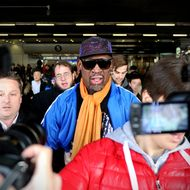 """Former US basketball player Dennis Rodman (C) is surrounded by the media as he arrives at Beijing International Airport from North Korea on January 13, 2014.  Rodman returned to China from Pyongyang after a seven-day trip where he sang """"Happy birthday to you!"""" to North Korean leader Kim Jong-Un on January 8.         AFP PHOTO / WANG ZHAO        (Photo credit should read WANG ZHAO/AFP/Getty Images)"""