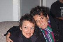 "Rocker Lou Reed with wife Laurie Anderson a kiss backstage at ""Arts on the Highwire,"" a benefit concert for the New York Arts Recovery Fund at the Hammerstein Ballroom. The fund assists artists and arts organizations struggling in the aftermath of the Sept. 11  disaster. (Photo By: Richard Corkery/NY Daily News via Getty Images)"