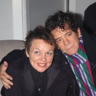 Rocker Lou Reed with wife Laurie Anderson a kiss backstage at