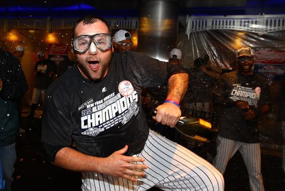 Joba Chamberlain #62 of the New York Yankees celebrates winning the American League East Division Championship after their 14-2 win against the Boston Red Sox on October 3, 2012 at Yankee Stadium.
