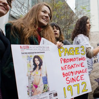 Feminist campaigners protest outside the UK offices of News International in east London on November 17, 2012 against the continued use of topless photographs of women on page 3 of
