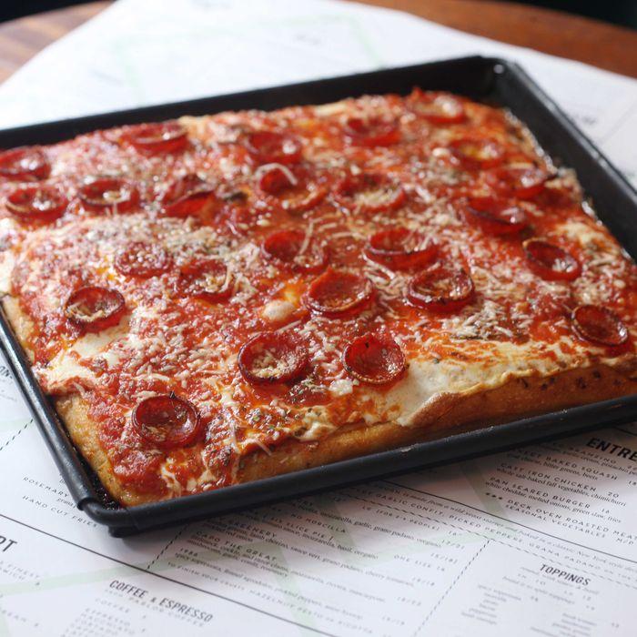 The square grandma-style pizza, with tomato sauce, mozzarella, basil, and oregano.