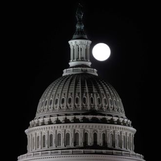 The full moon rises behind the U.S. Capitol Dome in Washington March 19, 2011.