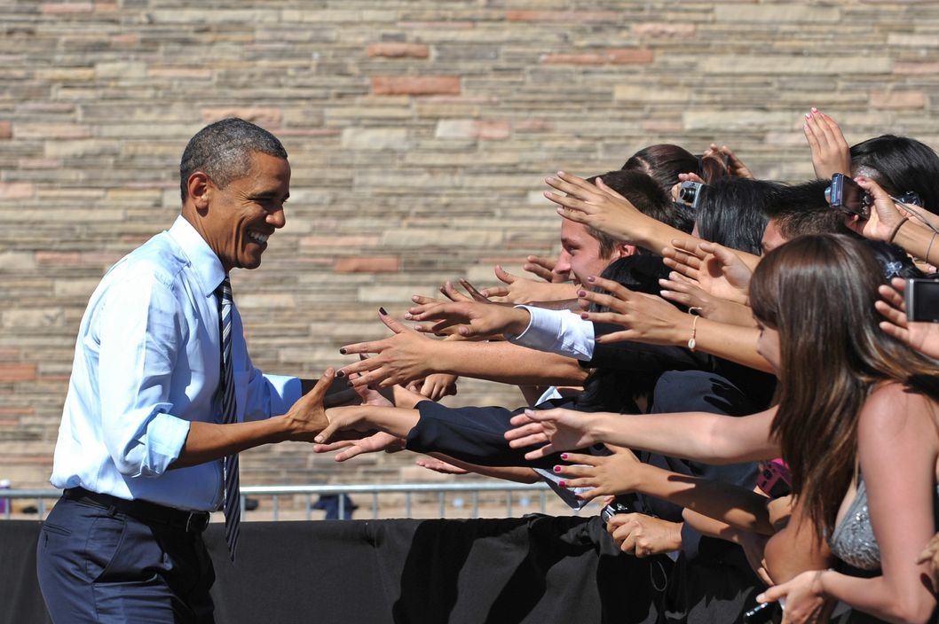 US President Barack Obama greets supporters as he arrives to speak on his proposed American Jobs Act September 27, 2011 at Abraham Lincoln High School in Denver, Colorado.