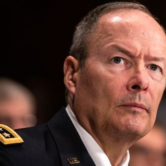 General Keith Alexander, Director of the National Security Agency, listens during a hearing of the Senate Judiciary on Capitol Hill October 2, 2013 in Washington, DC. The committee called James R. Clapper, the director of national intelligence, Alexander and others to testify about Foreign Intelligence Surveillance Act and surveillance on American citizens.