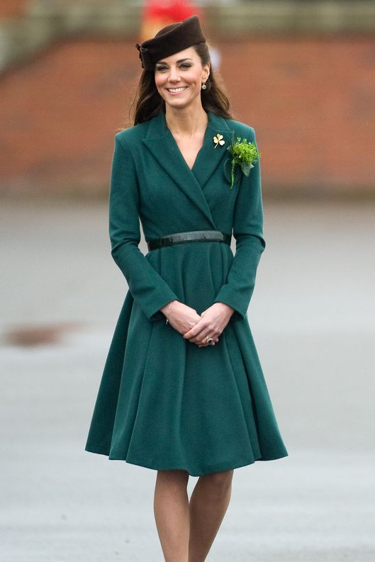 ALDERSHOT, ENGLAND - MARCH 17: Catherine, Duchess of Cambridge takes part in a St Patrick's Day parade as she visits Aldershot Barracks on St Patrick's Day on March 17, 2012 in Aldershot, England. The Duchess presented shamrocks to the Irish Guards at a St Patrick's Day parade during her visit. (Photo by Samir Hussein/WireImage)