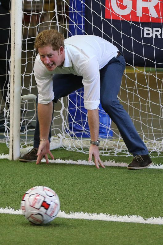 BELO HORIZONTE, BRAZIL - JUNE 24:  Prince Harry plays football with young school children during a visit to Minas Tenis Clube on the second day of his tour of Brazil on June 24, 2014 in Belo Horizonte, Brazil. Prince Harry is on a four day tour of Brazil that will be followed by two days in Chile. (Photo by Niall Carson - Pool/Getty Images)